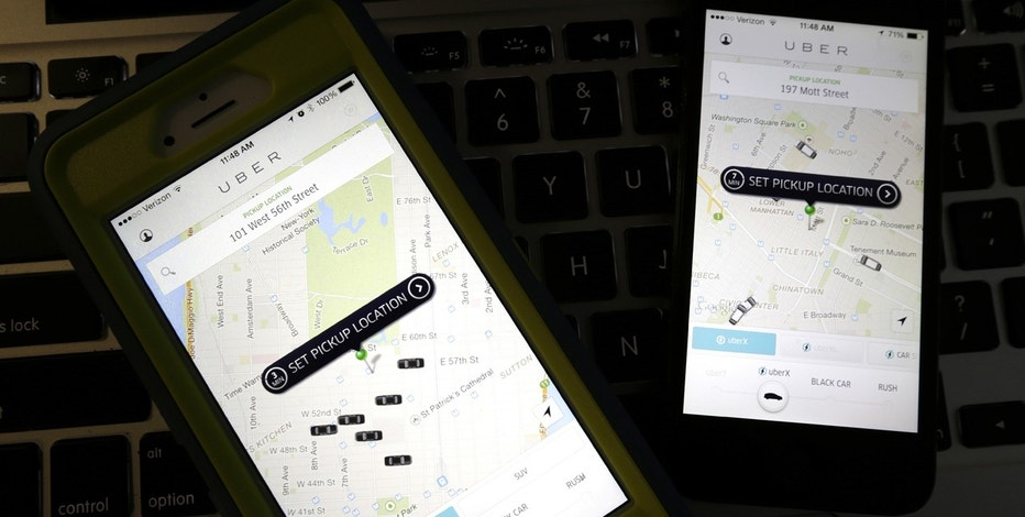 This Friday, Nov. 21, 2014, file photo taken in Newark, N.J., shows smartphones displaying Uber car availability in New York. Uber is enabling passengers to tip its U.S. drivers with a tap on its ride-hailing app for the first time, part of a push to recast itself as a company with a conscience and a heart. Besides the built-in tipping option announced Tuesday, June 20, 2017, Uber is giving drivers an opportunity to make more money when passengers keep them waiting or don't cancel rides within two minutes.
