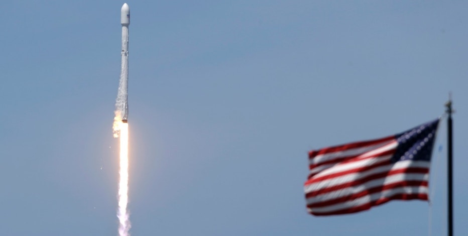 A Falcon 9 SpaceX rocket carrying a communications satellite that will provide television broadcast and data communications services over southeast Europe lifts off from pad 39A at the Kennedy Space Center in Cape Canaveral, Fla., Friday, June 23, 2017. (AP Photo/John Raoux)