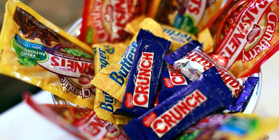 Nestle candy products are displayed the company's news conference in New York October 22, 2010.