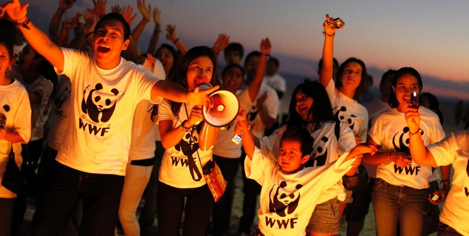 World Wildlife Fund (WWF) activists demonstrate on the sidelines of the UN Climate Change Conference COP16 in Cancun December 5, 2010. The conference in Cancun have far lower ambitions than last year's Copenhagen summit, which fell short of an all-encompassing deal to help slow floods, droughts, heatwaves and rising sea levels. REUTERS/Jorge Silva (MEXICO - Tags: ENVIRONMENT) - RTXVFXV