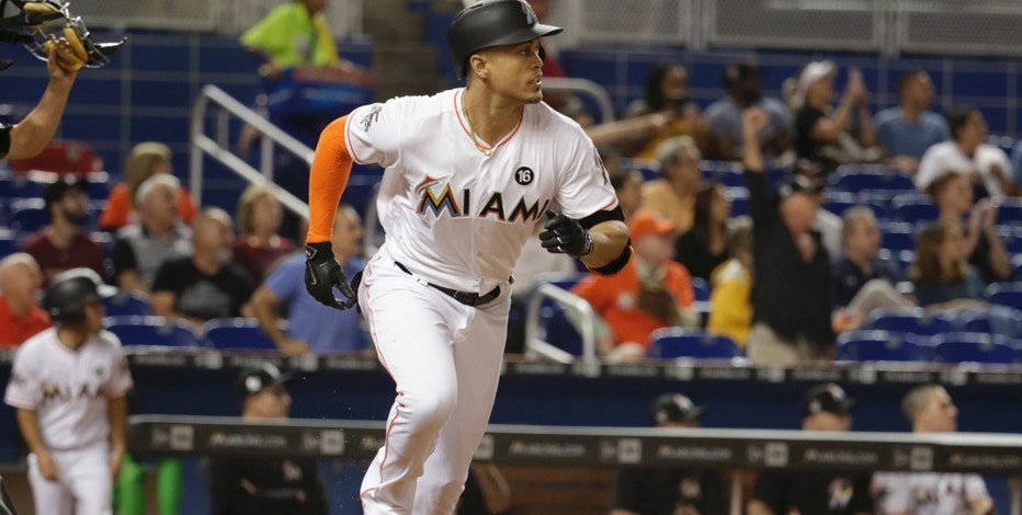 Miami Marlins' Giancarlo Stanton runs after hitting a double during the first inning of a baseball game against the Arizona Diamondbacks, Friday, June 2, 2017, in Miami. (AP Photo/Lynne Sladky)