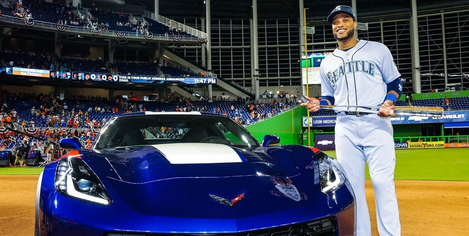 2017 MLB All-Star Game MVP Robinson Cano of the Seattle Mariners standing next to a 2017 Chevrolet Corvette Grand Sport.