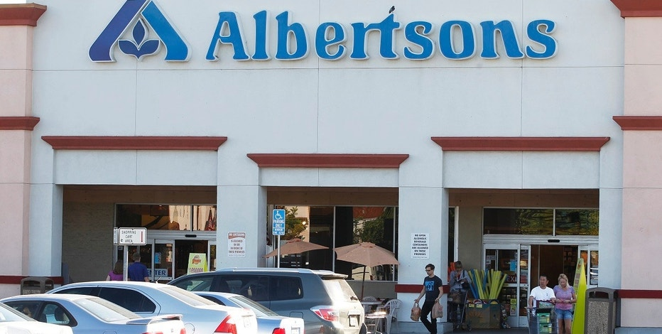 Customers leave an Albertsons grocery store with their purchases in Burbank, California July 17, 2012. Albertsons is owned by Supervalu, the third-largest U.S. grocery chain with other brands such as Jewel-Osco and Save-A-Lot. C&S Wholesale Grocers would be interested in buying the distribution business of grocer Supervalu Inc, which last week said it was exploring a sale of all or part of the company, the Wall Street Journal reported on Monday citing people familiar with the matter. REUTERS/Fred Prouser (UNITED STATES - Tags: BUSINESS) - RTR3513D