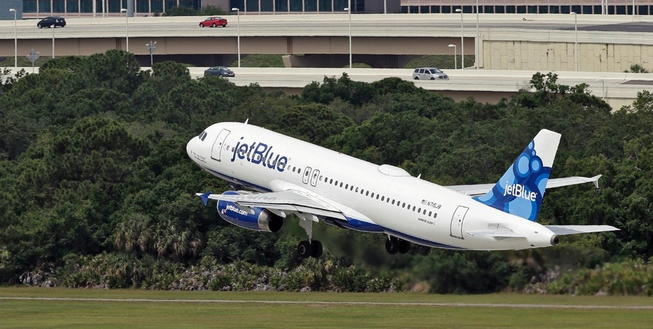 FILE - In this Thursday, May 15, 2014, file photo, a JetBlue Airways Airbus A320-232 takes off from the Tampa International Airport in Tampa, Fla. (AP Photo/Chris O'Meara, File)