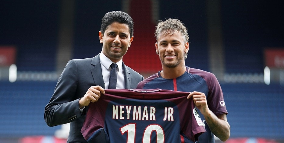 Soccer Football - Paris Saint-Germain F.C. - Neymar Jr Press Conference - Paris, France - August 4, 2017   New Paris Saint-Germain signing Neymar Jr and Chairman and CEO Nasser Al-Khelaifi pose with the club shirt   REUTERS/Christian Hartmann - RTS1ADNH
