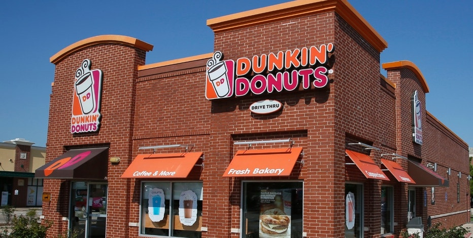 "FILE - This Thursday, July 28, 2016, file photo shows a Dunkin' Donuts in Edmond, Okla. Dunkin' is thinking about dumping ""Donuts"" from its name.  (AP Photo/Sue Ogrocki, File)"