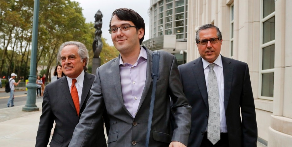 FILE - In this Thursday, July 27, 2017, file photo, former biotech CEO Martin Shkreli, center, leaves federal court with his attorney Benjamin Brafman, left, in New York. A jury began deliberations Monday, July 31, 2017, at  Shkreli's federal securities fraud trial. (AP Photo/Julie Jacobson, File)
