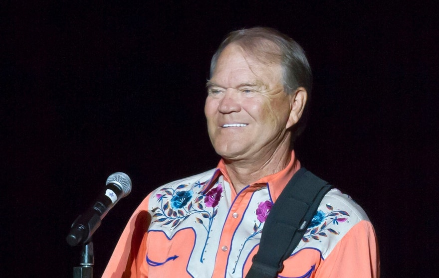 This Sept. 6, 2012 file photo shows singer Glen Campbell performing during his Goodbye Tour in Little Rock, Ark. (AP Photo/Danny Johnston, File)