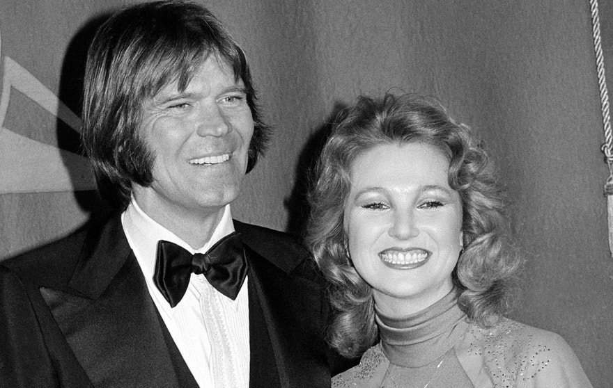 In this Feb. 15, 1979 file photo, country singers Glen Campbell, left, and Tanya Tucker, engaged to one another, are shown at the Grammy Awards in Los Angeles. (AP Photo, File)