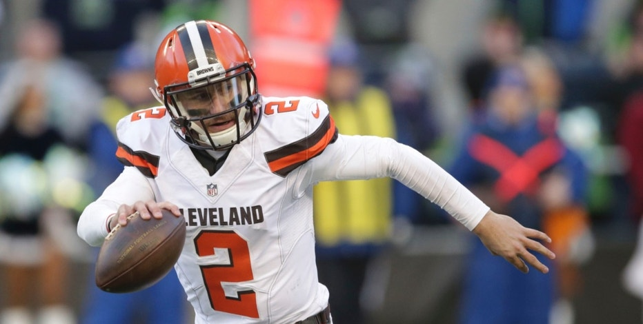 FILE - In this Sunday, Dec. 20, 2015 file photo, Cleveland Browns quarterback Johnny Manziel looks to pass against the Seattle Seahawks in the second half of an NFL football game in Seattle. Johnny Manziel's agent, Drew Rosenhaus, has told the troubled quarterback to seek help or he will no longer represent him, Wednesday, April 13, 2016  (AP Photo/Scott Eklund, File)