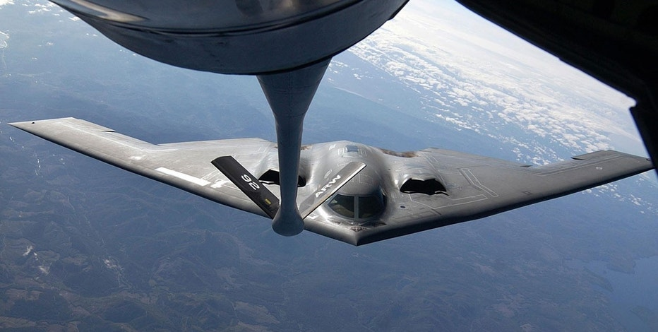 "The U.S. Air Force B-2 bomber ""Spirit of Oklahoma"" is refueled in-flight over Eastern Washington state on April, 27, 2002 while participating in ""Northern Edge,"" Alaska's largest annual joint training exercise."