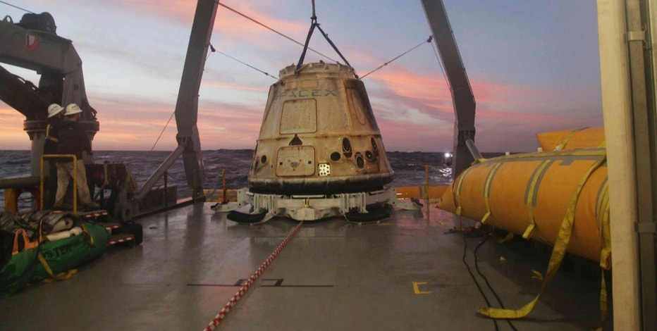 "FILE - In this Tuesday, Feb. 10, 2015 file photo made available by SpaceX, their Dragon capsule sits aboard a ship in the Pacific Ocean west of Mexico's Baja Peninsula after returning from the International Space Station, carrying about 3,700 lbs of cargo for NASA. SpaceX announced Monday, Feb. 27, 2017 that it would send two paying customers  to the moon next year on a private flight aboard its Dragon capsule. The company said the unnamed customers have paid ""a significant deposit"" for the moon trip.(AP Photo/SpaceX, File)"