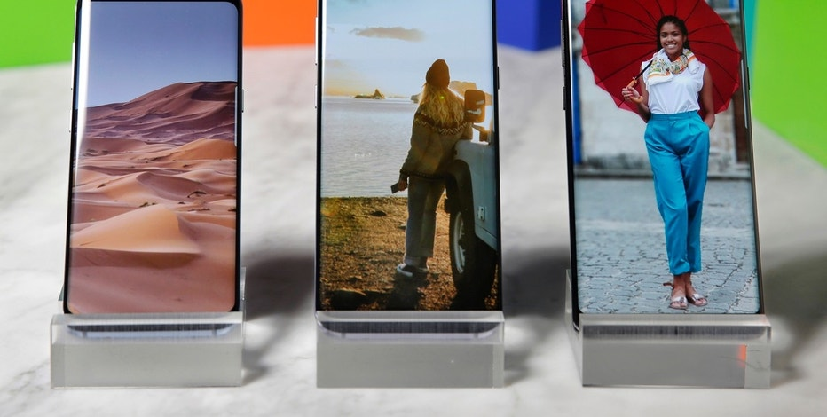 This Aug. 16, 2017, photo, shows a Samsung Galaxy S8, left, a Samsung Galaxy S8 Plus, center, and Samsung Galaxy Note 8 on display, in New York. (AP Photo/Richard Drew)