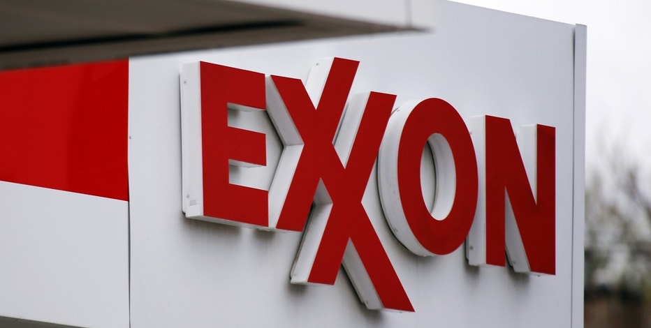 This April 29, 2014, file photo, shows an Exxon sign at a Exxon gas station in Carnegie, Pa.
