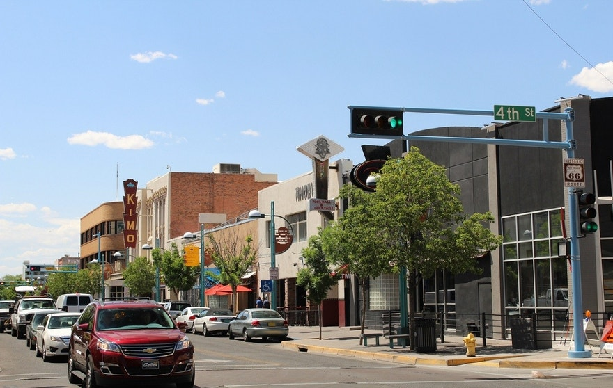 Looking west along historic Route 66 with the Kimo theater in the distance.  Central Ave. and 4th Street, downtown Albuquerque, New Mexico.