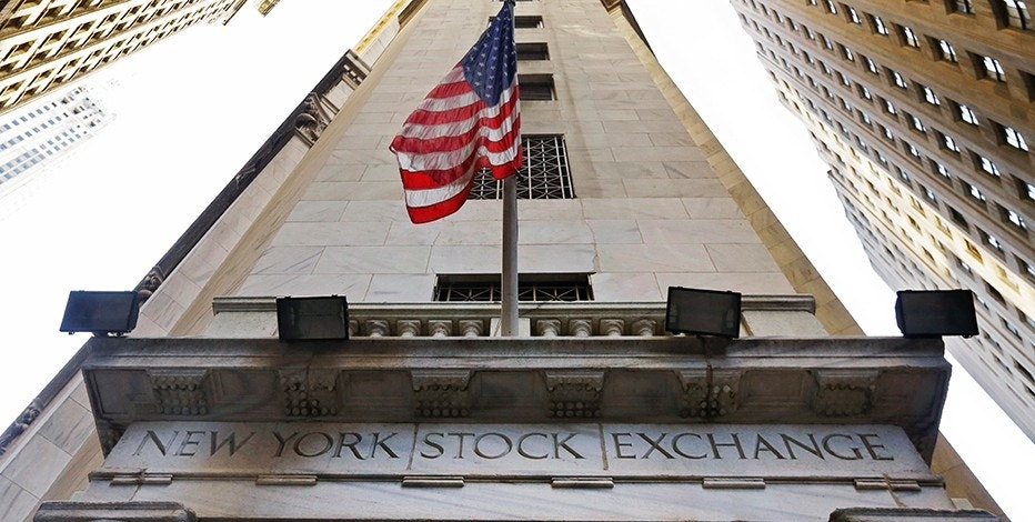 FILE - In this Friday, Nov. 13, 2015, file photo, the American flag flies above the Wall Street entrance to the New York Stock Exchange. U.S. stock indexes edged higher in morning trading Friday, June 30, 2017, recovering some of their losses from a day earlier. (AP Photo/Richard Drew, File)