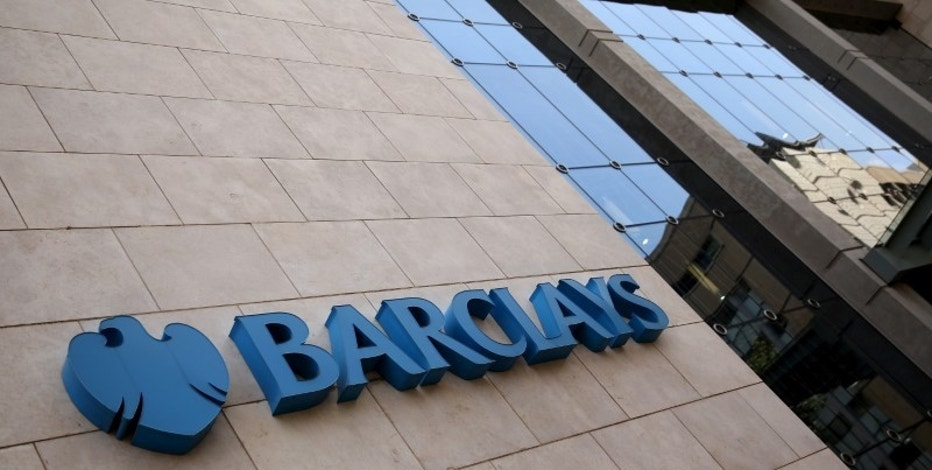 FILE PHOTO: A Barclays logo is pictured outside the Barclays towers in Johannesburg, South Africa, December 16, 2015. REUTERS/Siphiwe Sibeko/File Photo