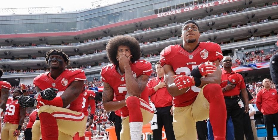 "FILE - In this Oct. 2, 2016 file photo, from left, San Francisco 49ers outside linebacker Eli Harold, quarterback Colin Kaepernick and safety Eric Reid kneel during the national anthem before an NFL football game against the Dallas Cowboys in Santa Clara, Calif. A new poll shows that most white Americans disapprove of athletes protesting during the playing of ""The Star-Spangled Banner.""  (AP Photo/Marcio Jose Sanchez, File)"