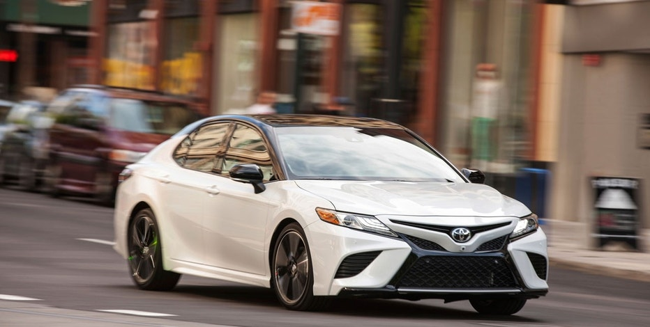 This photo provided by Toyota shows the 2018 Toyota Camry, one of the most popular midsize sedans sold in America. It's been completely redesigned for 2018, with better handling and improved fuel economy without any compromises to usability or utility.