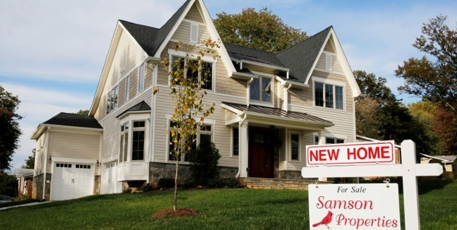 FILE PHOTO --  A real estate sign advertising a new home for sale is pictured in Vienna, Virginia, U.S. October 20, 2014.       REUTERS/Larry Downing/File Photo