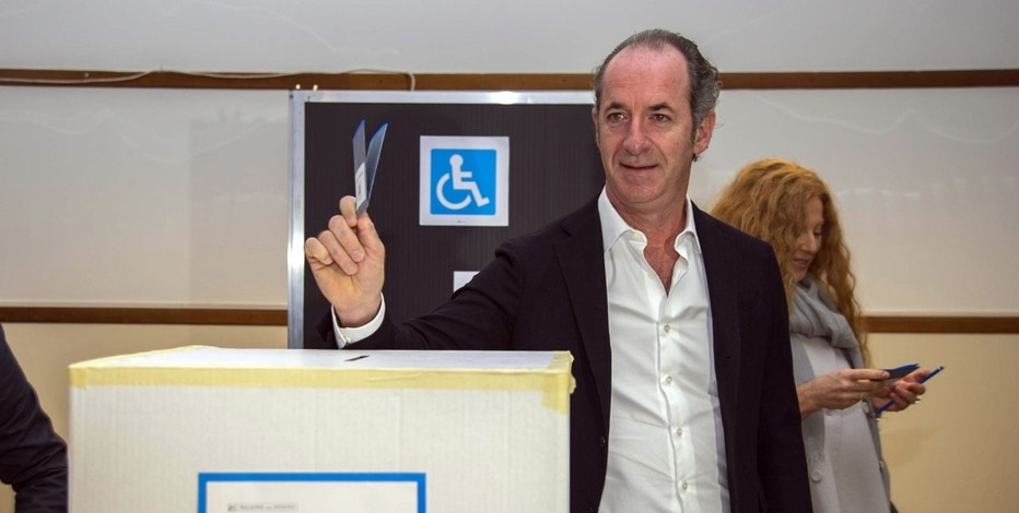 President of Veneto Region, Luca Zaia casts his ballot for a referendum in San Vendemiano, near Treviso, Italy, Sunday, Oct.22, 2017. Voters in the wealthy northern Italian regions of Lombardy and Veneto are heading to the polls to decide if they want to seek greater autonomy from Rome, riding a tide of self-determination that is sweeping global politics. (Riccardo Gregolin/ANSA via AP)