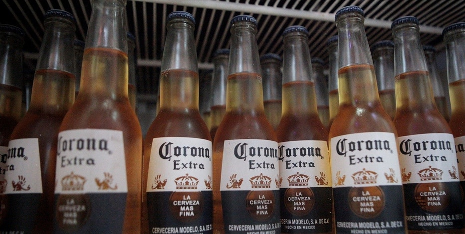 Bottles of Corona beer sit in a fridge at a bar in Cancun June 29, 2012.   REUTERS/Victor Ruiz Garcia/File Photo
