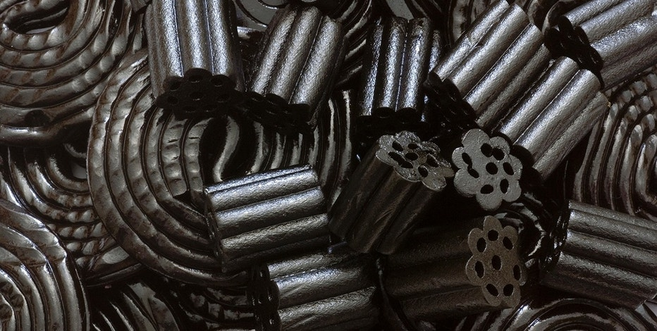 A close-up picture of sweet and salt liqorice.