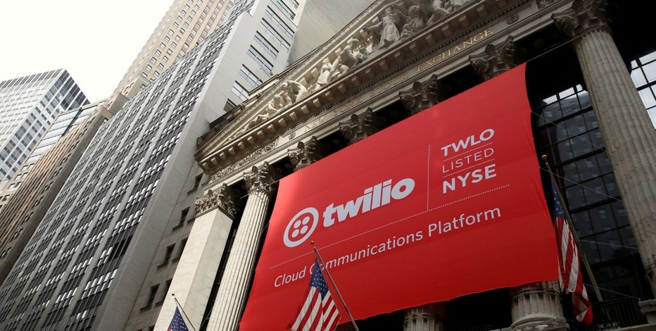 FILE PHOTO:    A banner for communications software provider Twilio Inc., hangs on the facade of the New York Stock Exchange (NYSE) to celebrate the company's IPO in New York City, U.S., June 23, 2016. REUTERS/Brendan McDermid