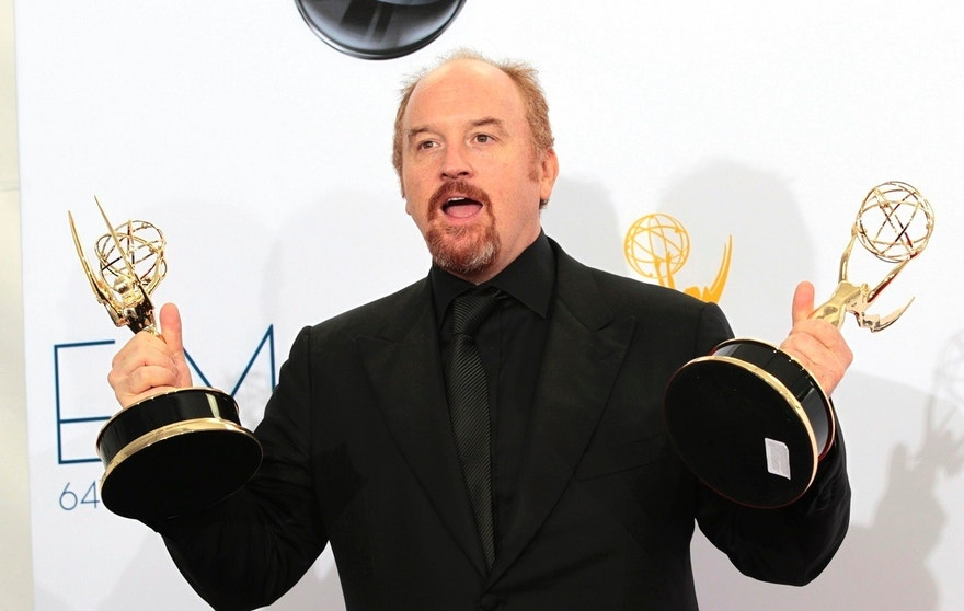 "Louis C.K. holds the Emmy awards for outstanding writing for a variety special for ""Louis C.K. Live at the beacon Theatre"" and outstanding writing in a comedy series for his show ""Louie"" at the 64th Primetime Emmy Awards in Los Angeles September 23, 2012."