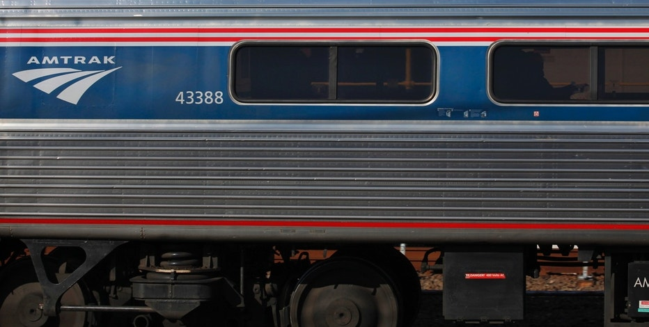 Travelers are seen inside of an AMTRAK train at the Harrison station in New Jersey November 17, 2012. REUTERS/Eduardo Munoz (UNITED STATES  - Tags: TRANSPORT BUSINESS) - RTR3AJBJ