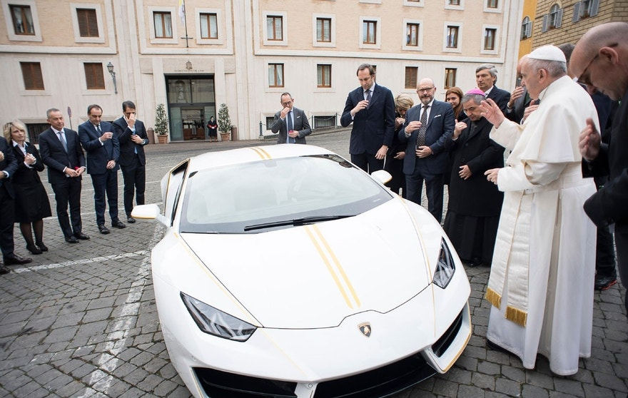 Pope Francis blesses a Lamborghini donated to him by the luxury sports car maker, at the Vatican, Wednesday, Nov. 15, 2017. The car will be auctioned off by Sotheby's, with the proceeds going to charities including one aimed at helping rebuild Christian communities in Iraq that were devastated by the Islamic State group.