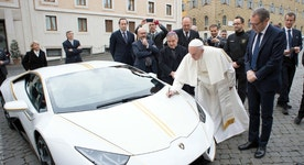 Pope Francis receives white-and-gold Lamborghini Huracan for charity auction