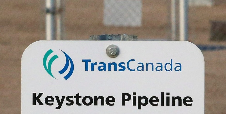 FILE- This Nov. 6, 2015, file photo shows a sign for TransCanada's Keystone pipeline facilities in Hardisty, Alberta, Canada. (Jeff McIntosh/The Canadian Press via AP, File)
