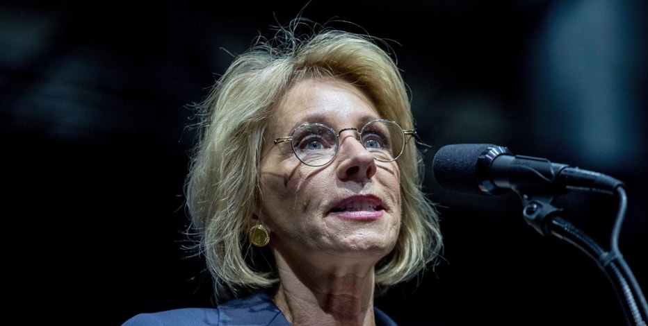 FILE - In this Dec. 9, 2016 file photo, Education Secretary-designate Betsy DeVos speaks in Grand Rapids, Mich. Propelled by populist energy, President-elect Donald Trump's candidacy broke long-standing conventions and his incoming Cabinet embodies a sharp turn from the outgoing Obama administration.  (AP Photo/Andrew Harnik, File)