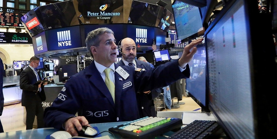 Specialist Anthony Rinaldi, left, and trader Fred Demarco work on the floor of the New York Stock Exchange, Monday, April 17, 2017. Technology and consumer-focused stocks are leading indexes slightly higher in early trading as investors return from a long holiday weekend. (AP Photo/Richard Drew)