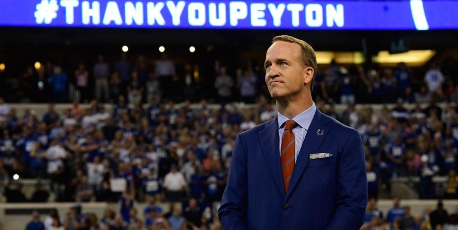Oct 8, 2017; Indianapolis, IN, USA; Indianapolis Colts former quarterback Peyton Manning attends a halftime ceremony as his jersey is retired and he is inducted into the Colts Ring of Honor at Lucas Oil Stadium.
