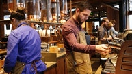 Starbucks baristas prepare drinks during a preview of its new Reserve Roastery and Tasting Room in Seattle, Washington December 4, 2014.   REUTERS/Jason Redmond  (UNITED STATES - Tags: BUSINESS FOOD) - RTR4GS2Z