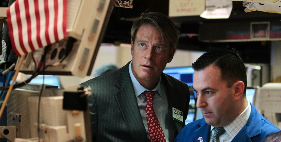 Barclays Capital traders Patrick Murphy and James Sculli work on the floor of the New York Stock Exchange September 22, 2011.  Stocks tumbled on Thursday, extending losses for a fourth straight session, as the Federal Reserve's weak outlook for the U.S. economy and disappointing data China heightened fears about a global recession.  REUTERS/Brendan McDermid (UNITED STATES - Tags: BUSINESS)