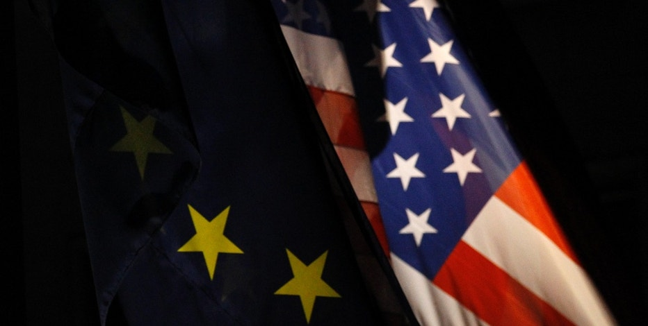 An EU flag and an U.S. flag are pictured in front of the German Finance Ministry before a meeting between German Finance Minister Wolfgang Schaeuble and U.S.Treasury Secretary Timothy Geithner in Berlin December 6, 2011. REUTERS/Tobias Schwarz (GERMANY - Tags: POLITICS BUSINESS)