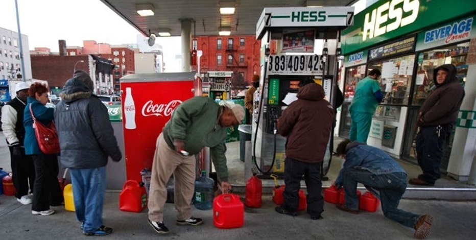 Customers wait in line for fuel at a Hess gas station in Brooklyn, N.Y., after Hurricane Sandy, Nov. 9, 2012.