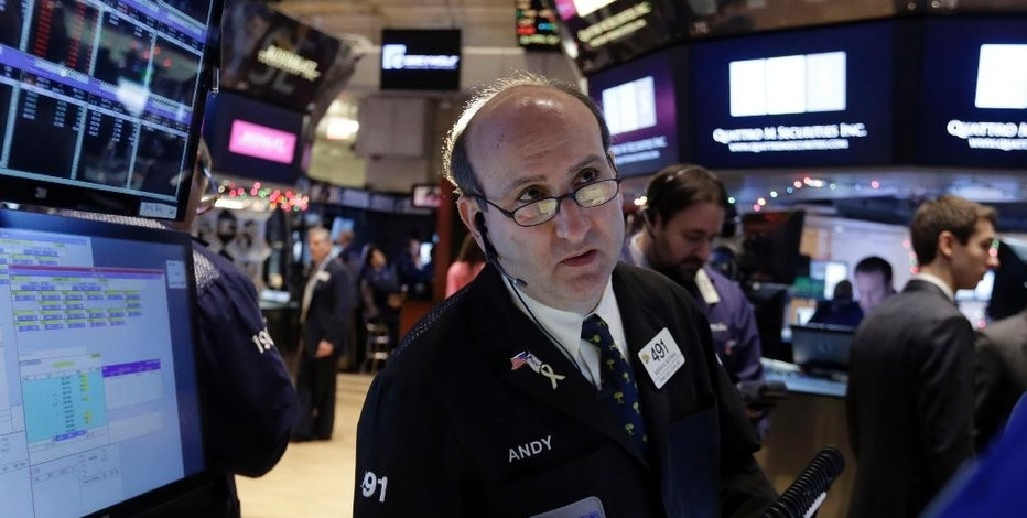 Trader Andrew Silverman works on the floor of the New York Stock Exchange Tuesday, Jan. 6, 2015. The U.S. stock market is edging higher in early trading as the price of oil extends its slump. (AP Photo/Richard Drew)