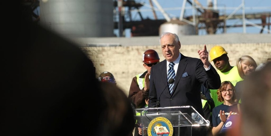 California High Speed Rail Authority Chairman Dan Richards speaks to the crowd at the ground breaking event Tuesday, Jan. 6, 2015, in Fresno, Calif. The $68 billion project faces challenges from Republicans in Congress eager to reduce government spending and Central Valley farmers suing to block the train from crossing their fields. The train would whisk travelers at 200 mph between Los Angeles and San Francisco in less than three hours. (AP Photo/Gary Kazanjian)