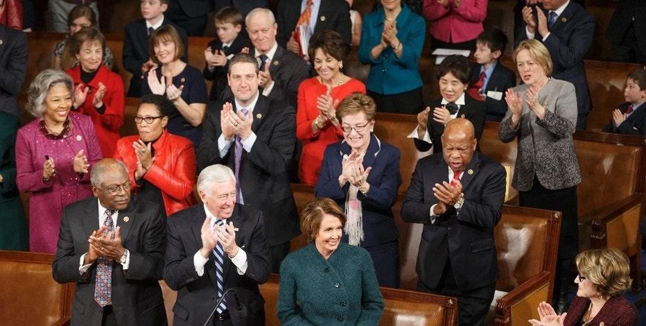 House Minority Leader Nancy Pelosi of Calif., is applauded by Democratic members of the House of Representatives during nominations for speaker as lawmakers gather for opening session of the 114th Congress, at the Capitol in Washington, Tuesday, Jan. 6, 2015. House Speaker John Boehner, R-Ohio, won a third term despite a tea party-backed effort to unseat him. Front row, from left are, House Assistant Minority Leader James Clyburn of S.C., House Minority Whip Steny Hoyer of Md. and Pelosi. (AP Photo/J. Scott Applewhite)
