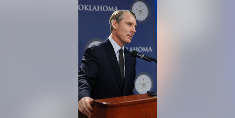 Oklahoma state Treasurer Ken Miller Oklahoma state Treasurer Ken Miller listens to a question at a news conference in Oklahoma City, Wednesday, Jan. 7, 2015. Miller said the state's economy performed well to close out 2014, but that continued low oil prices will eventually start to drag down other sources of revenue like income and sales taxes. (AP Photo/Sue Ogrocki)