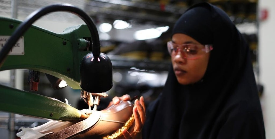 FILE - In this Tuesday, Dec. 2, 2014 file photo, Muslima Hassan trims the rubber bottom of an L.L. Bean boot at a facility in Lewiston, Maine. Payroll processor ADP reports how many jobs private employers added in December on Wednesday, Jan. 7, 2015. (AP Photo/Robert F. Bukaty, File)