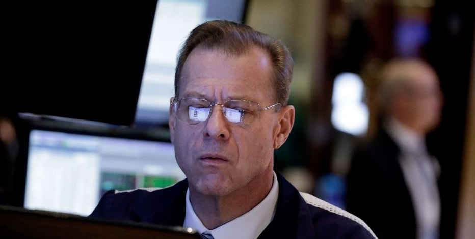 Trader Eugene Roseo studies his screens as he works on the floor of the New York Stock Exchange Monday, Jan. 12, 2015. Stocks are moving lower in early trading, led by a decline in energy stocks as the price of oil fall again. (AP Photo/Richard Drew)