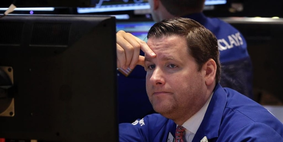 Trader Gregg Maloney works on the floor of the New York Stock Exchange Monday, Jan. 12, 2015. Stocks are moving lower in early trading, led by a decline in energy stocks as the price of oil fall again. (AP Photo/Richard Drew)