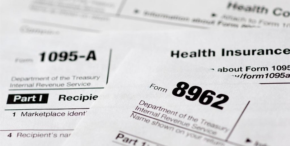 This Aug. 21, 2014 file photo shows health care tax forms 8962, 1095-A, and 8965,  in Washington. Being uninsured in America will cost you more in 2015. In 2015, all taxpayers have to report to the Internal Revenue Service for the first time whether or not they had health insurance the previous year. Most will check a box. It's also when the IRS starts collecting fines from some uninsured people, and deciding if others qualify for exemptions. (AP Photo/Carolyn Kaster, File)