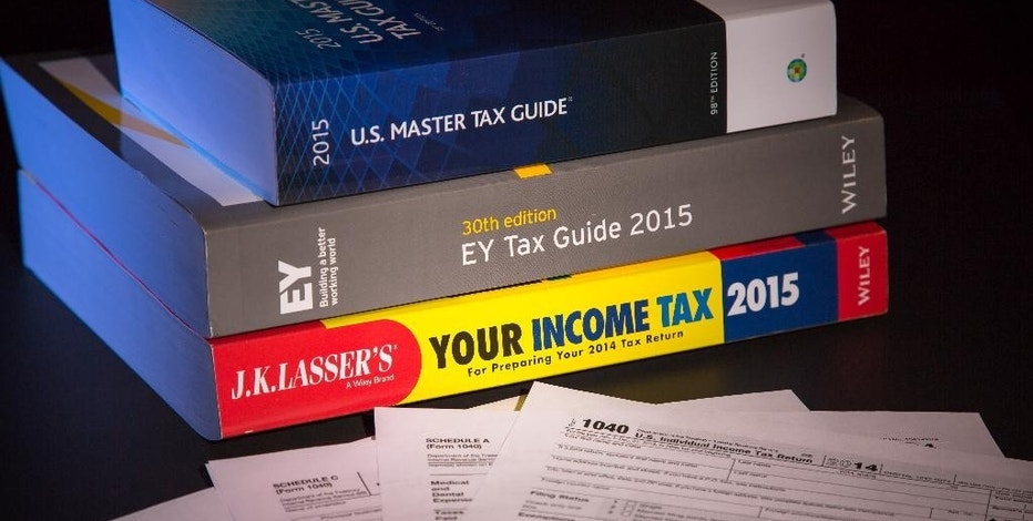 """In this Frday, Jan. 9, 2015 photo, three of several commercially available tax guides to help prepare this year's tax return are photographed in Washington. """"There's a lot to look for. It is kind of complicated. This is not easy stuff,"""" said Barbara Weltman, contributing editor to the tax guide """"J.K. Lasser's Your Income Tax 2015."""" She said the good news is that most people use a paid preparer or software to do their taxes, and they'll be walked through the questions that have to be answered for the health insurance section of the tax return.  (AP Photo/J. David Ake)"""