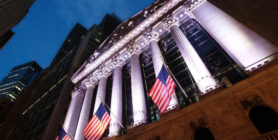 In this Oct. 8, 2014 photo, American flags fly in front of the New York Stock Exchange, in New York. U.S. stocks are rising in early trading Tuesday, Jan. 13, 2015, following two days of declines. (AP Photo/Mark Lennihan)